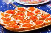 Red caviar on sandwich