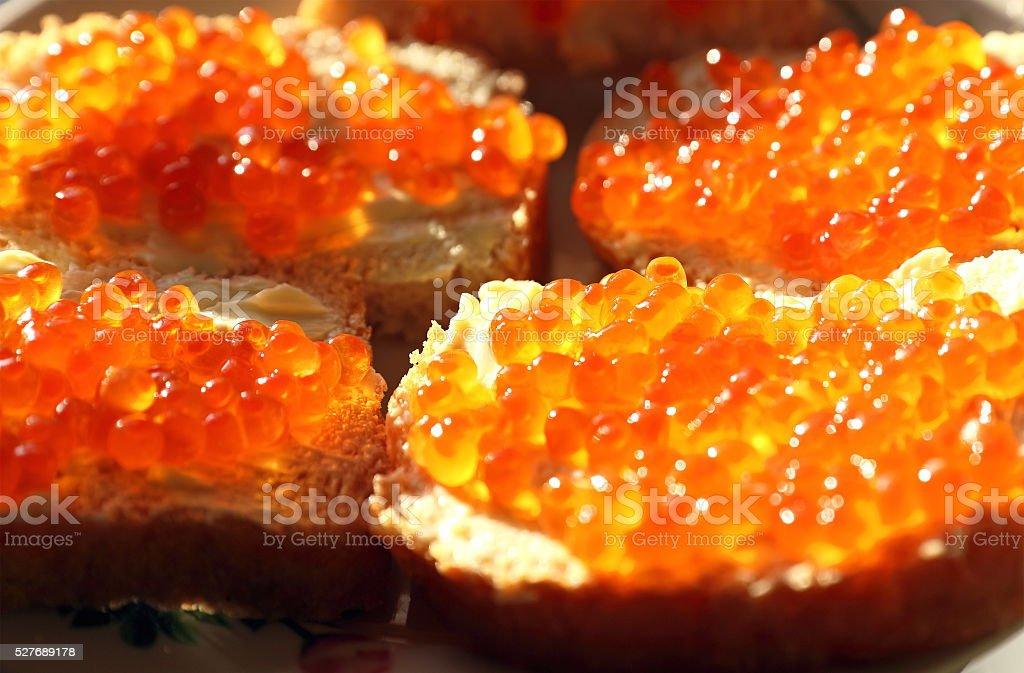 Red caviar with bread and oil stock photo