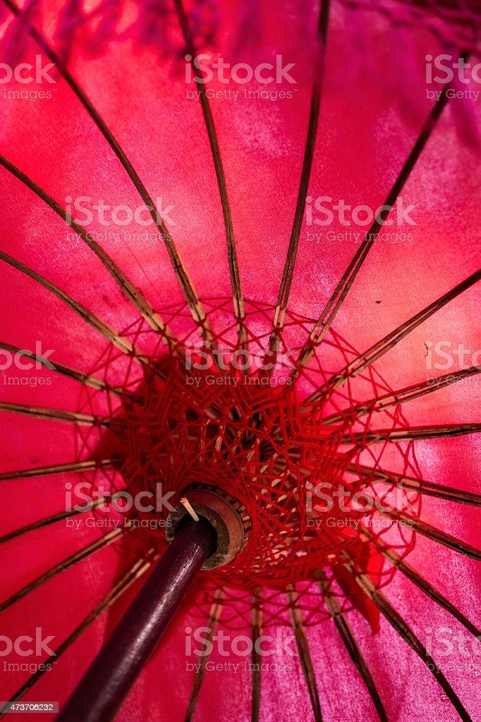 Red ceremonial umbrella in Bali temple stock photo