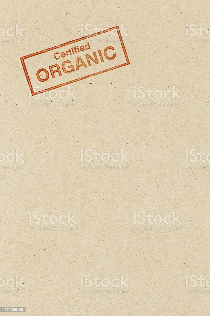 Red Certified Organic Rubber Stamp Impression on Brown Background Vt stock photo