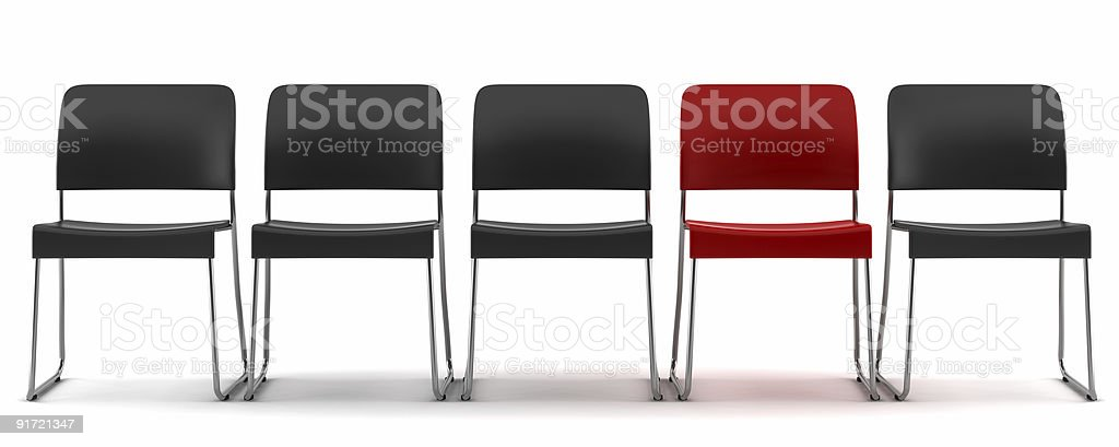 red chair among black chairs isolated on white background stock photo