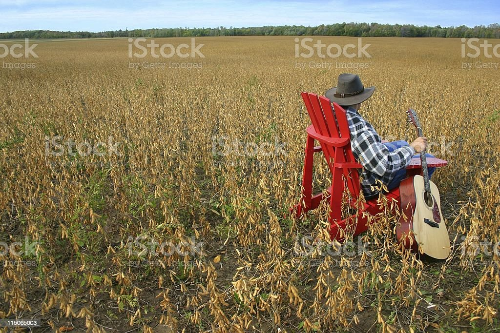 red chair and guitar with man stock photo