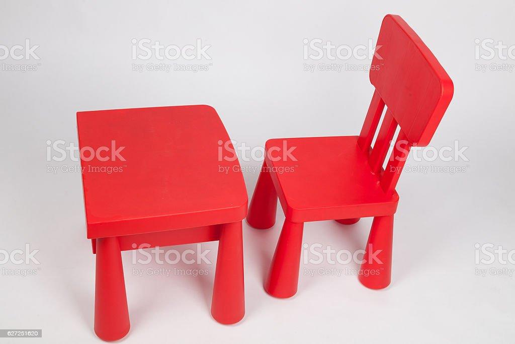 red chair and table for children in kindergarten preschool classroom stock photo