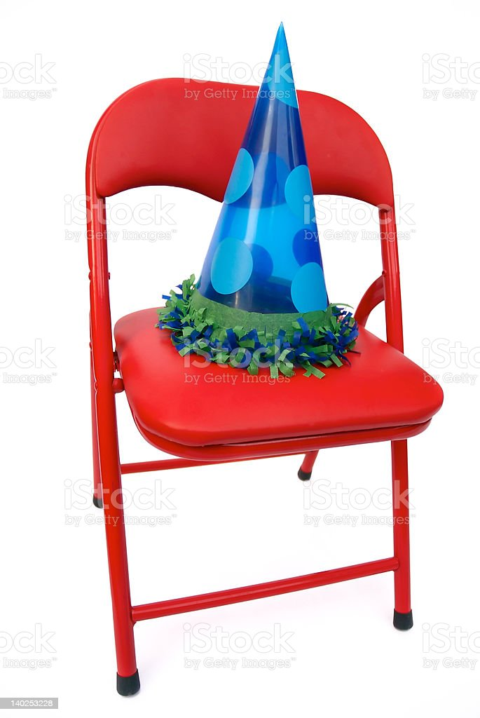 red chair with party hat royalty-free stock photo