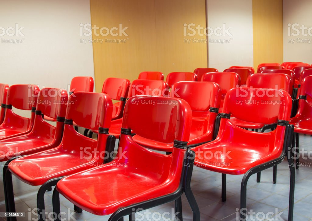 Red chairs in the meeting room. stock photo