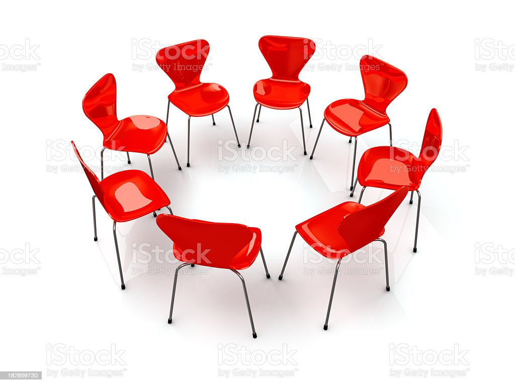 Red chairs in the shape of a circle against white backdrop stock photo