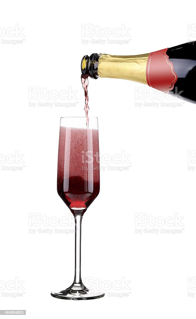 Red champagne pouring in a glass. royalty-free stock photo