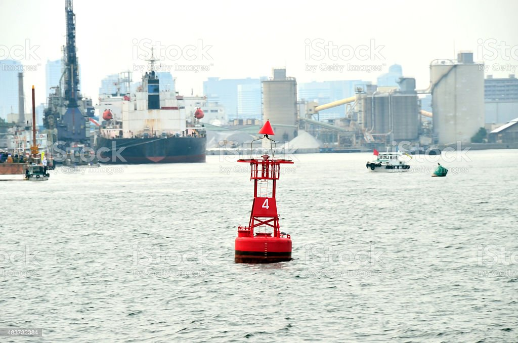 red channel marker buoy in the harbor stock photo