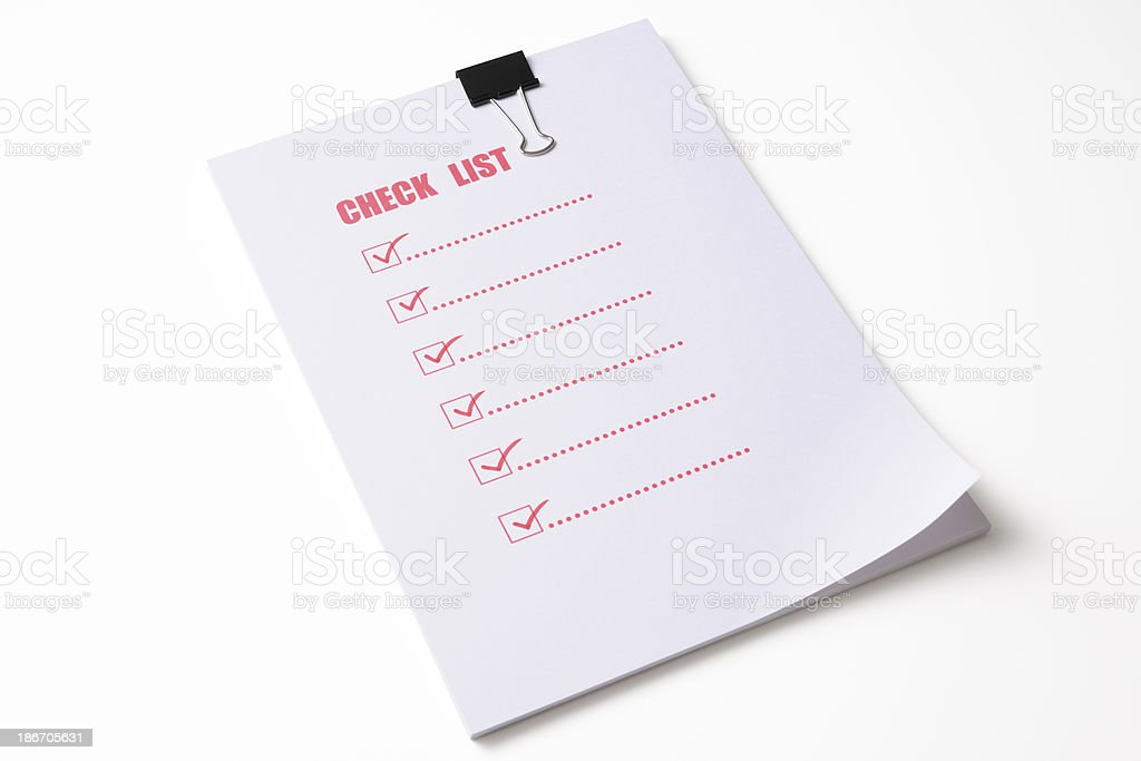 Red check list with metal clip on white background royalty-free stock photo