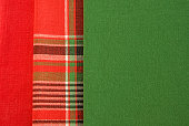 Red, checkered and green fabric.