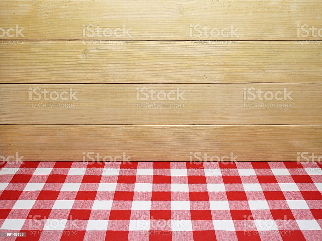 Red Checkered Tablecloth and Wooden Planks Background stock photo