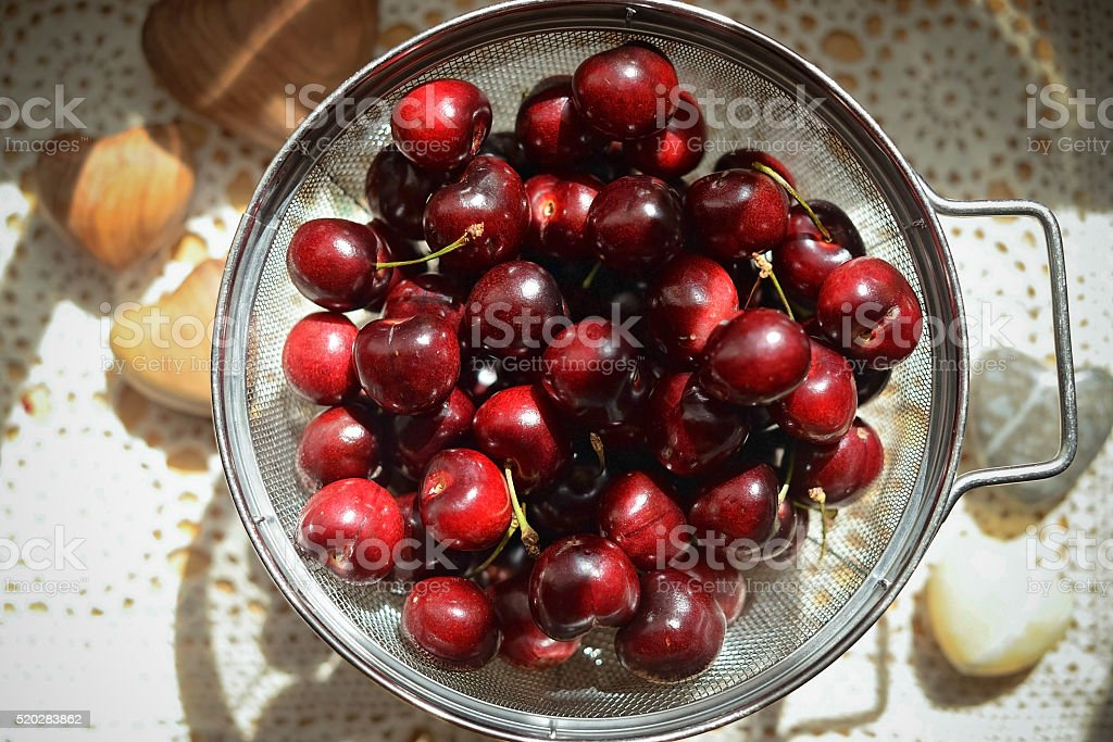 Red Cherries in a colander stock photo