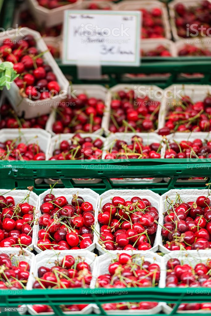 Red cherries in a market in Germany stock photo