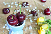 Red cherries in blue cup