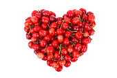 red cherry in heart shape isolated on white background