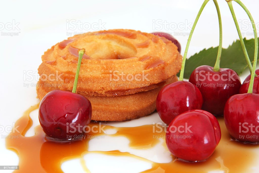 Red cherry with biscuit and syrup royalty-free stock photo