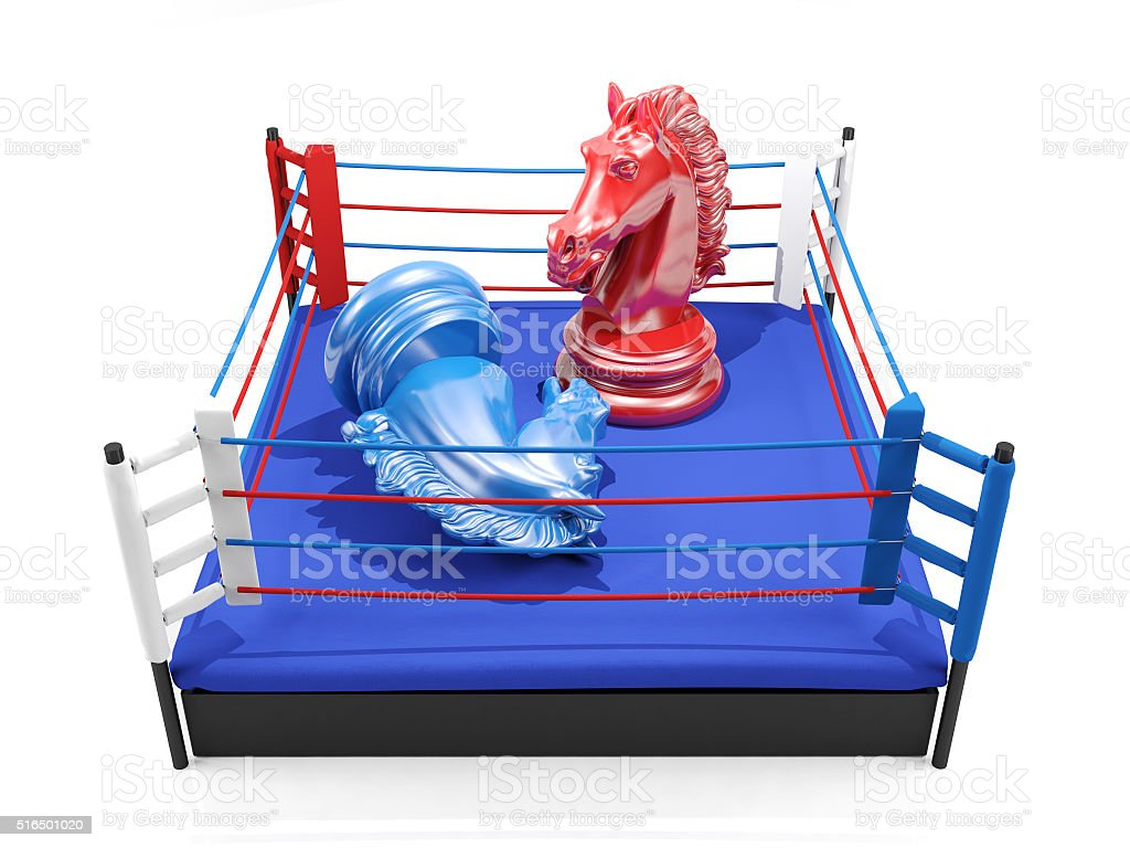 Red chess knight wins over blue chess knight on boxing ring stock photo