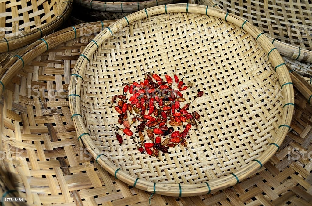Red Chili drying in a basket royalty-free stock photo