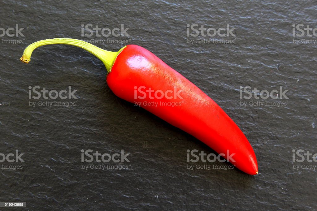red chili pepper on a slate plate stock photo