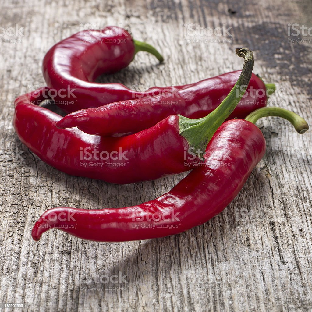 Red chili pepper on weathered wooden background royalty-free stock photo