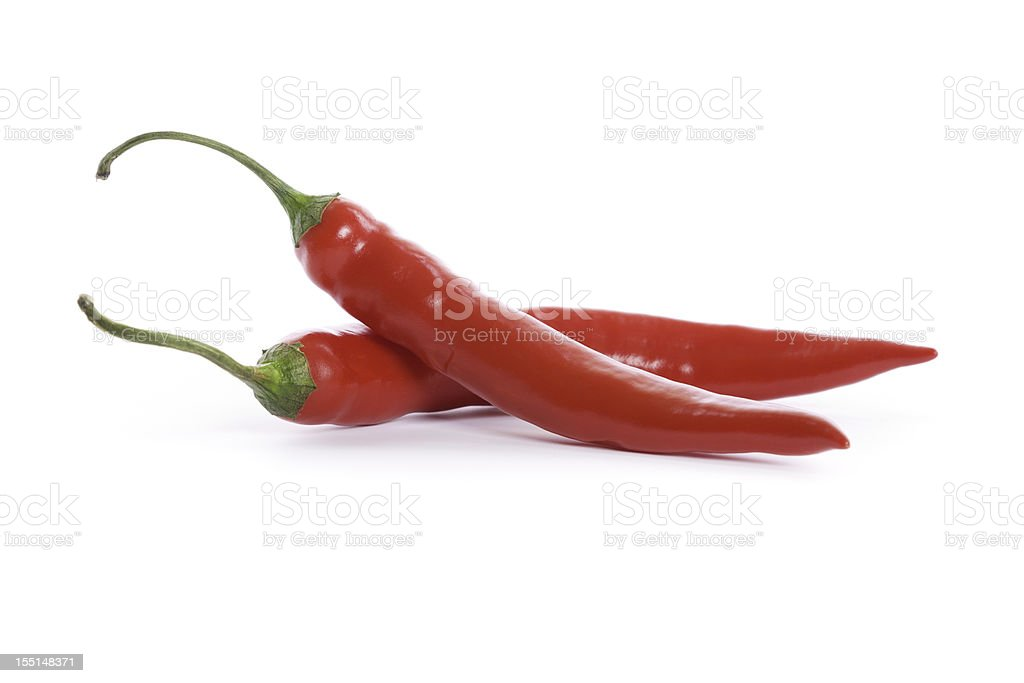 red chili peppers isolated on white stock photo