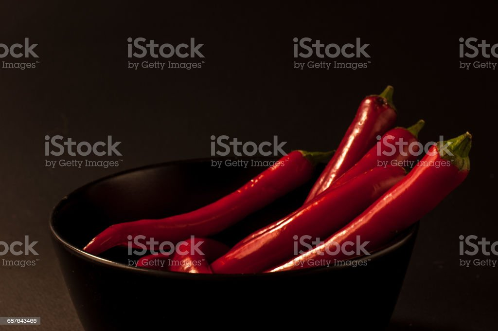 red Chili peppers on a black background stock photo