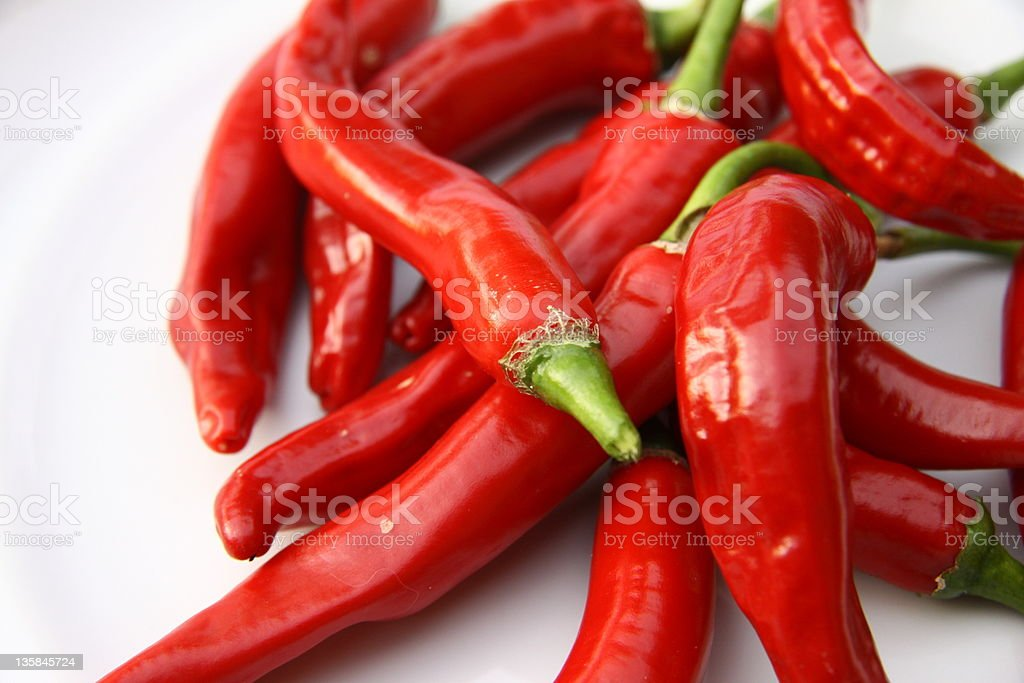 red chili peppers on white royalty-free stock photo