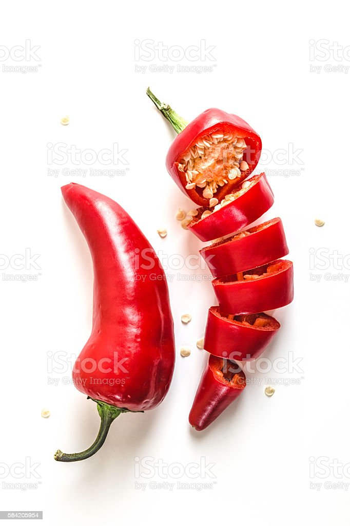Red Chili Peppers Sliced on White Background stock photo