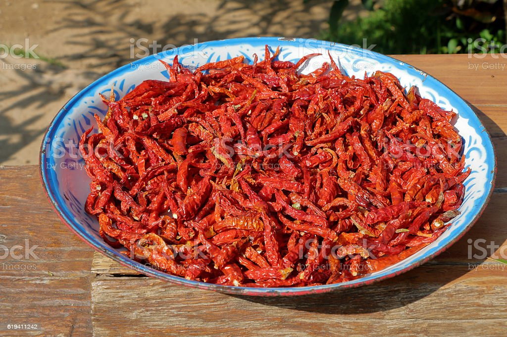 Red chilli pepper drying in the sun stock photo