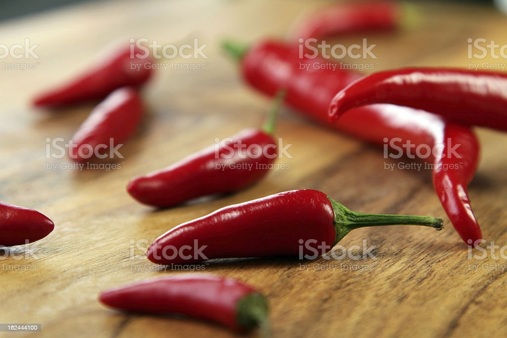 Red chilli peppers on the Cutting Board stock photo