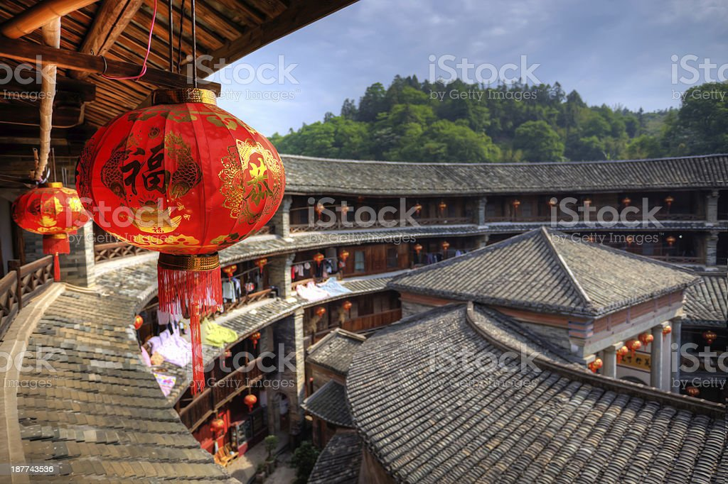 Red Chinese lantern in a Hakka Tulou traditional housing, Fujian stock photo
