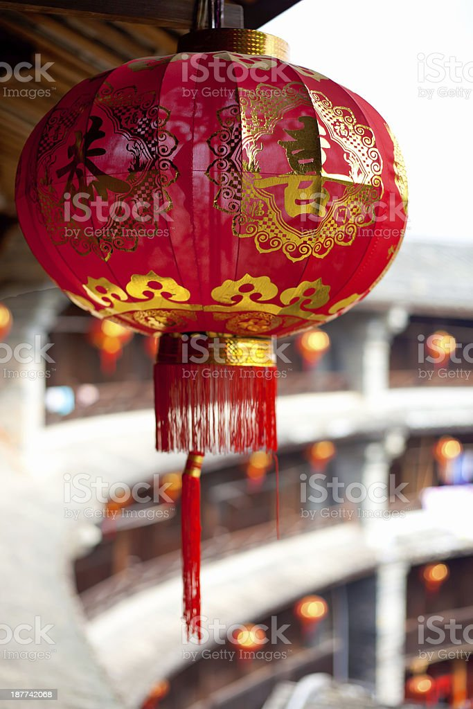 Red Chinese lantern in a Hakka Tulou traditional housing stock photo
