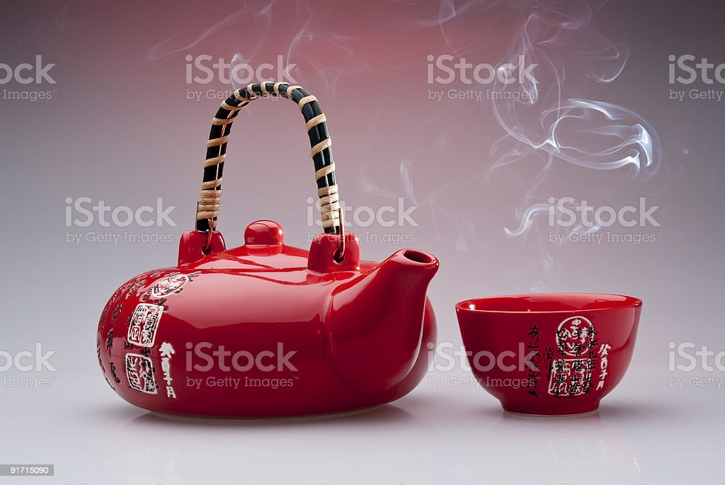 Red chinese teapot with steaming cup royalty-free stock photo