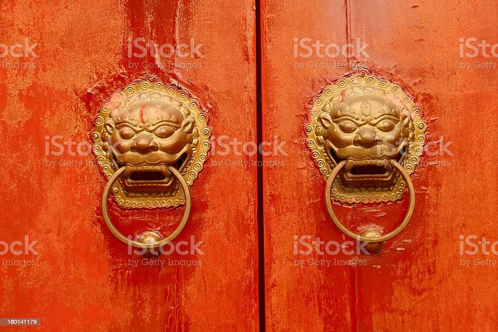 red Chinese temple doors with bronze lion knobs stock photo