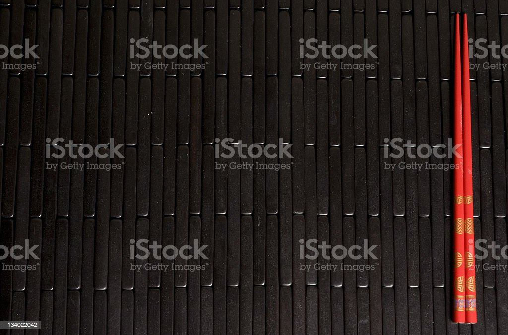 Red Chopsticks on Black Mat royalty-free stock photo