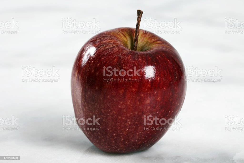 Red Christmas Apple on White Marble royalty-free stock photo