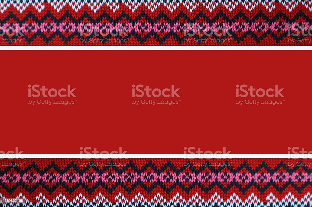 Red Christmas background with knitted border stock photo