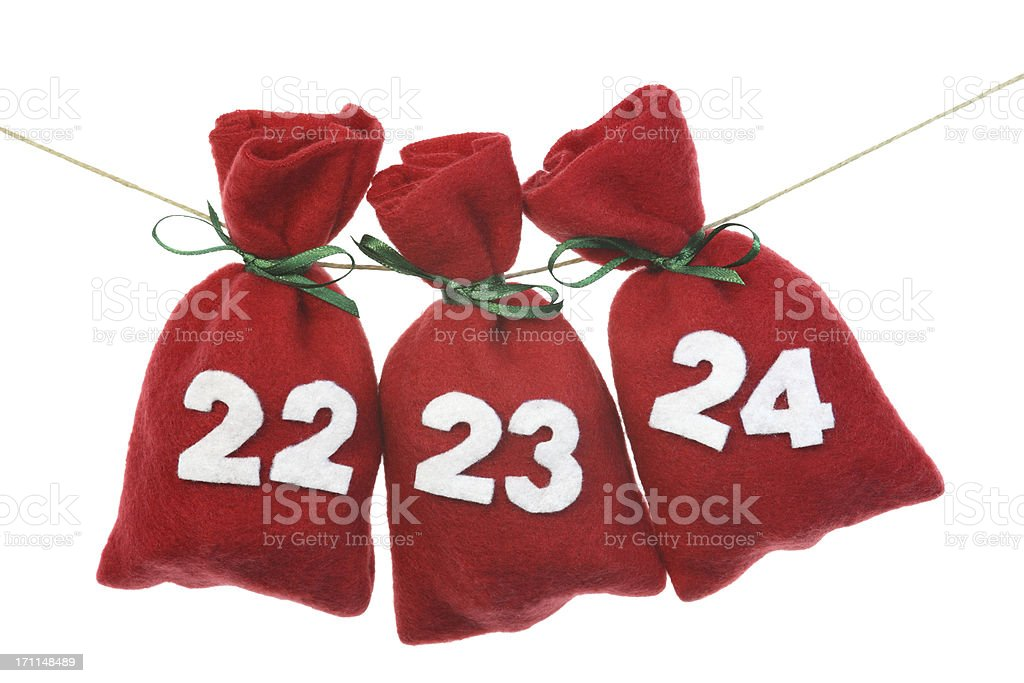 red Christmas bags for advent calendar on a string royalty-free stock photo