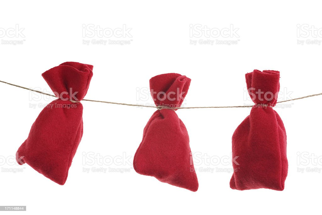 red Christmas bags for advent calendar on a string stock photo