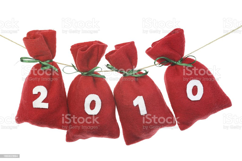 red Christmas bags (year 2010) on a string stock photo