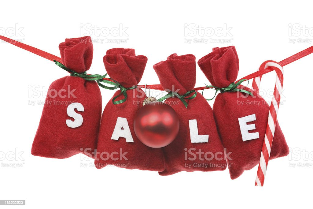 red Christmas bags (sale) on a string stock photo