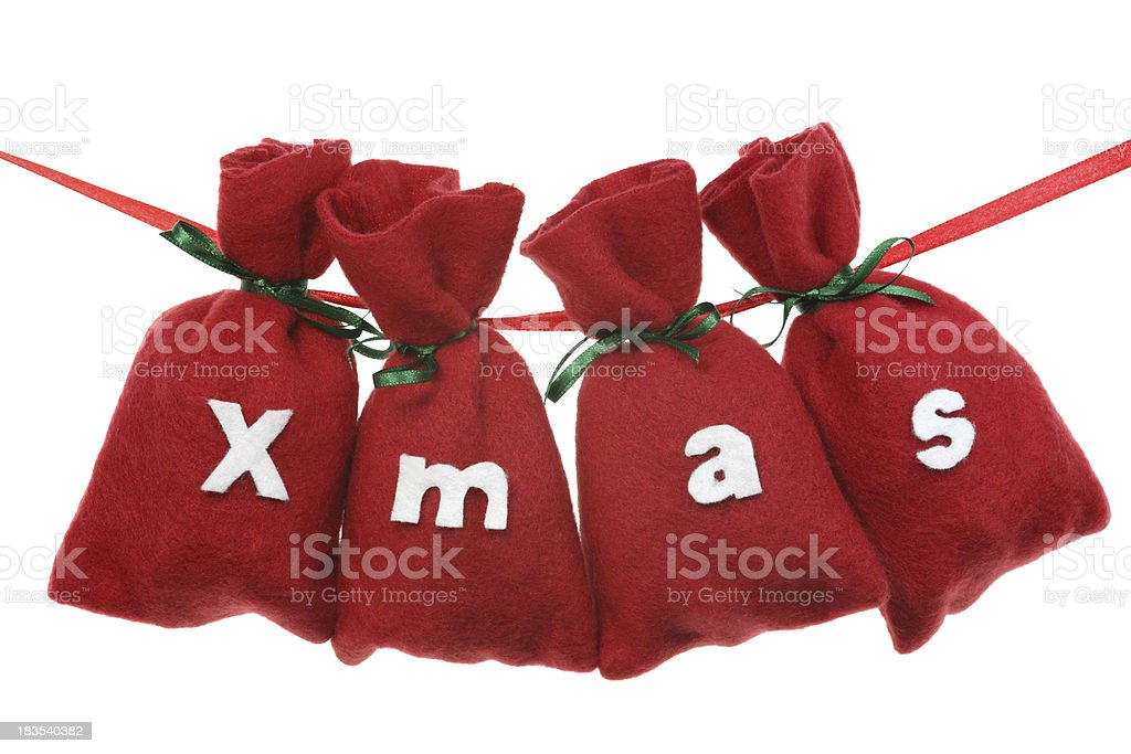 red Christmas bags (X mas) on a string stock photo