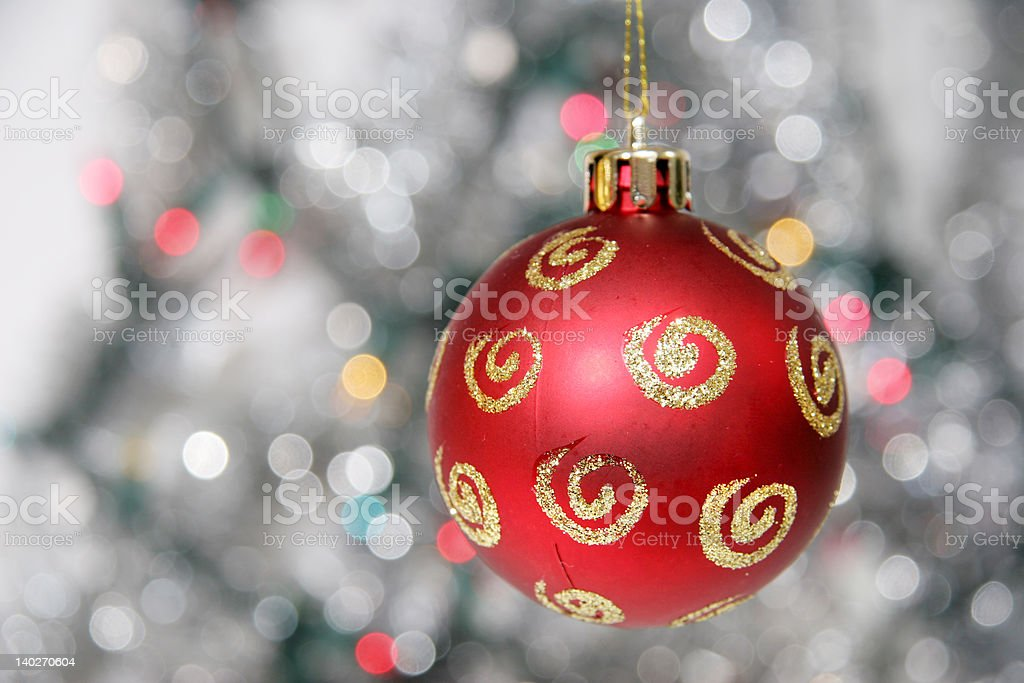Red christmas ball against cold background royalty-free stock photo