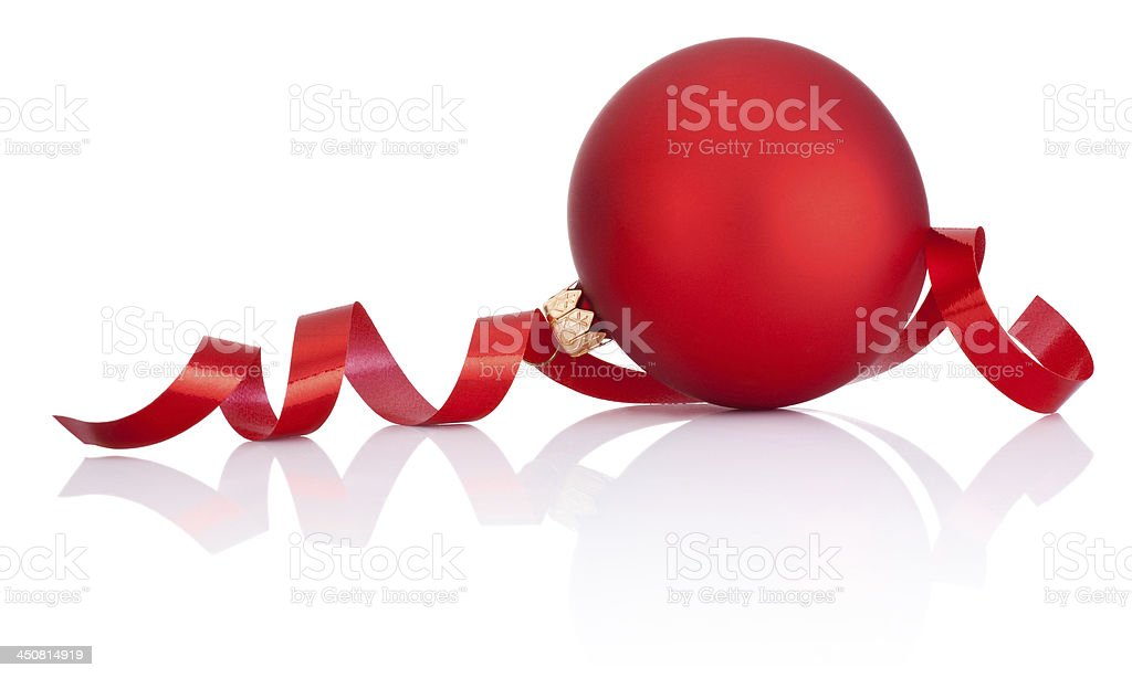Red Christmas ball and curling paper Isolated on white background royalty-free stock photo