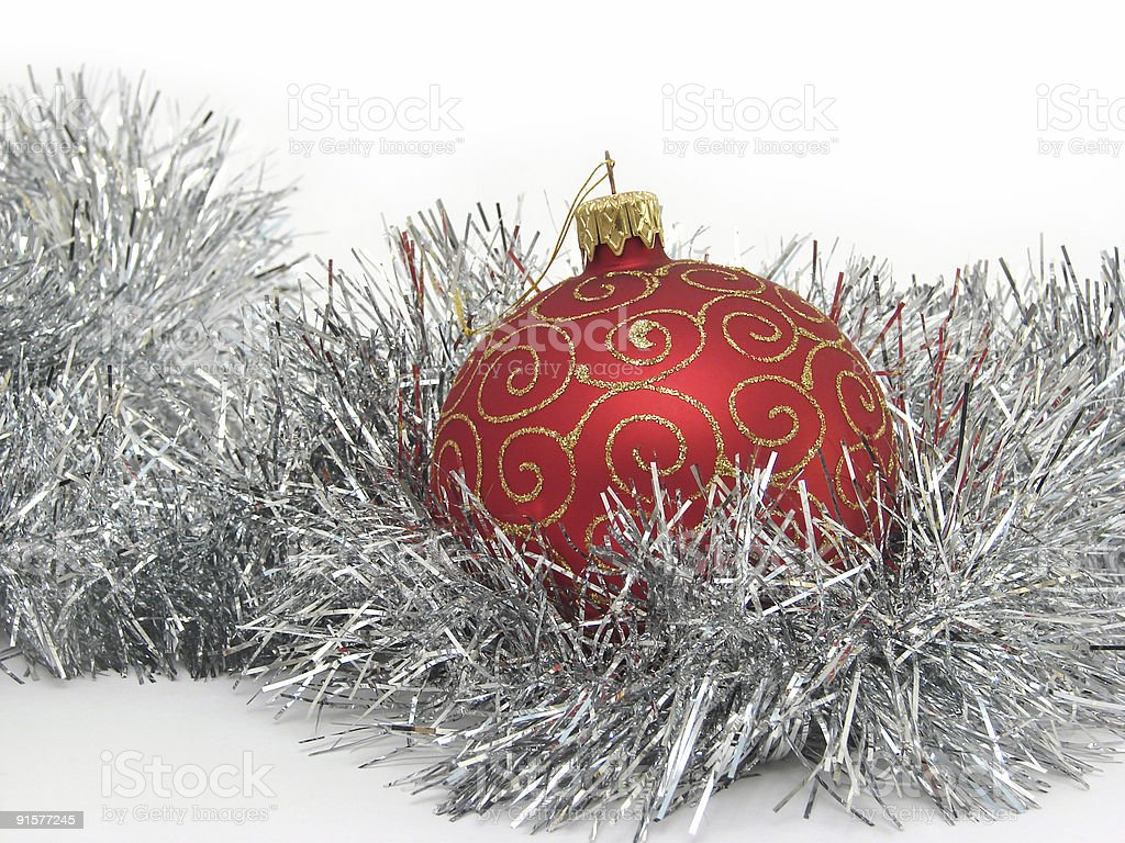 Red christmas ball and silver tinsel royalty-free stock photo
