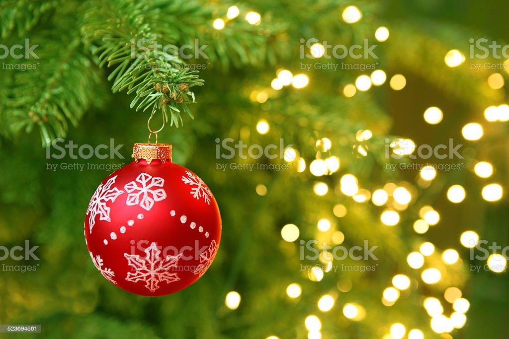 Red Christmas Ball Hanging on Christmas Tree with Blur Lights stock photo