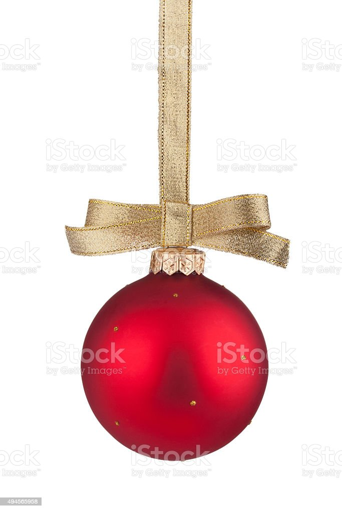 Red Christmas ball hanging on golden ribbon stock photo