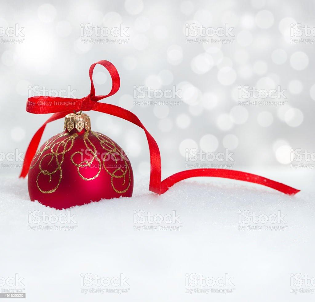 Red christmas ball on snow stock photo