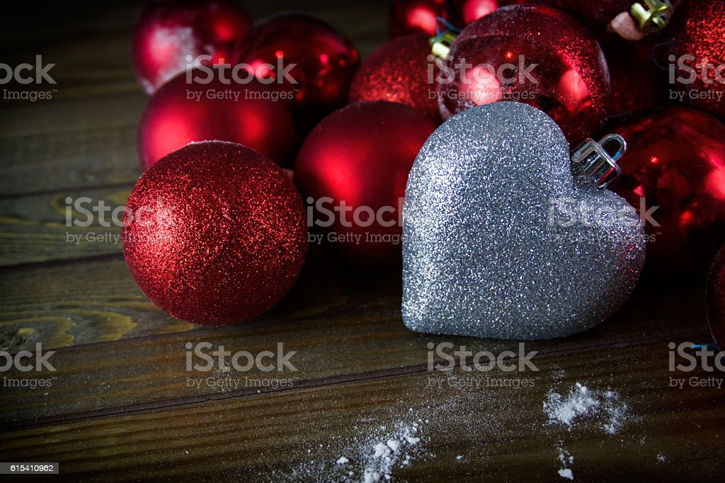 red Christmas balls, Christmas ornaments, silver heart stock photo