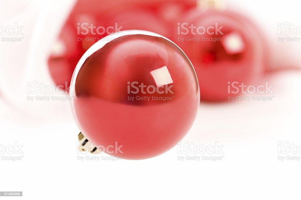 Red christmas balls in Santa hat on white stock photo